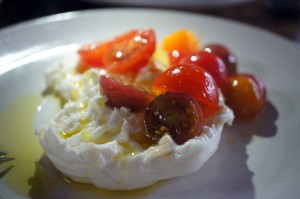 Blissful burrata & sunset-colored cherry tomatoes.