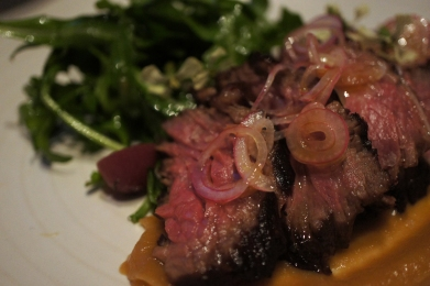 Hangar Steak with caramelized onion and grapes
