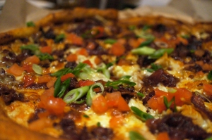 Black & Bleu Pizza~ BBQ Chicken, Bacon and Bleu Cheese crumbles on a perfectly baked crust.